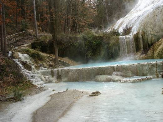 surrounded by a lush forest the hot springs bagni san filippo is one of the natural wonders of the val dorcia both for the properties of its waters and